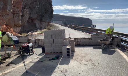 A wall is suddenly built to prevent usage along road closed 18 months ago.