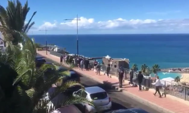30-40 North African migrants march in brief Puerto Rico protest overlooking Amadores Beach in Mogán